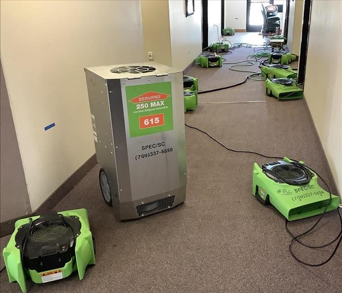 Hallway with SERVPRO drying equipment