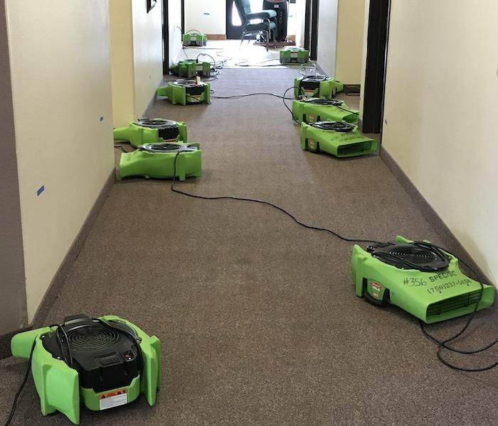 SERVPRO air movers on a carpet in a hallway