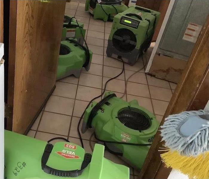 Four of our green dry machines drying the flood damage in this room