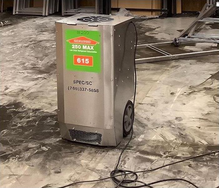 SERVPRO dehumidifier in water damaged room